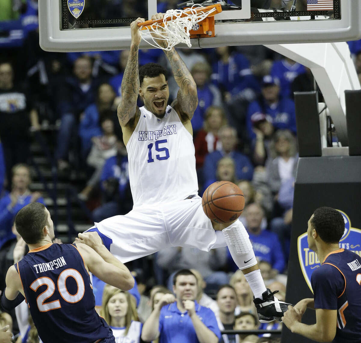 FILE - In this March 14, 2015, file photo, Kentucky forward Willie Cauley-Stein (15) dunks the ball as Auburn forward Alex Thompson (20) and Auburn guard Devin Waddell look on during the second half of an NCAA college basketball game in the semifinal round of the Southeastern Conference tournament in Nashville, Tenn. Cauley-Stein was selected to the AP All-America team, Monday, March 30, 2015. (AP Photo/Mark Humphrey, File)