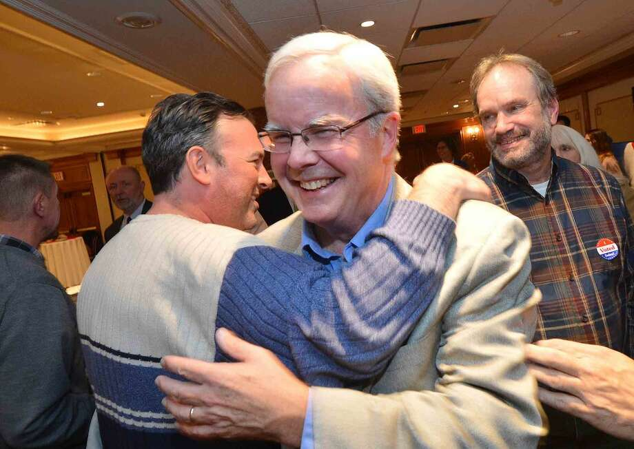 Hour Photo/Alex von Kleydorff Mike Lyons gets a congratulations from Bryan Meek during Republican Party Election night