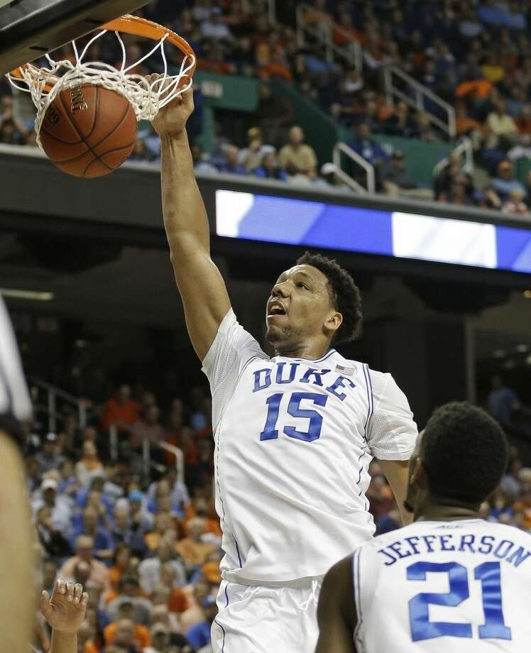 FILE - In this March 13, 2015, file photo, Duke's Jahlil Okafor (15) dunks against Notre Dame during the first half of an NCAA college basketball game in the semifinals of the Atlantic Coast Conference tournament in Greensboro, N.C. Okafor was selected to the Mens All-America team, Monday, March 30, 2015. (AP Photo/Bob Leverone, File)