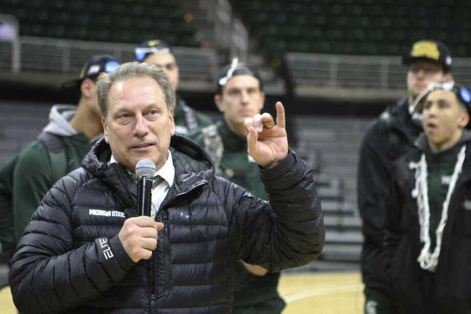 Michigan State coach Tom Izzo addresses the crowd Sunday, March 29, 2015, in East Lansing, Mich., that gathered to celebrate the team's win over Louisville earlier Sunday in the NCAA men's college basketball tournament regional final in Syracuse, N.Y. (AP Photo/The Citizen Patriot, Emily Lawler)