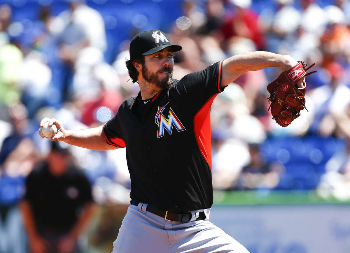 Miami Marlins starting pitcher Dan Haren (15) works in the first inning of an exhibition spring training baseball game against the New York Mets Monday, March 30, 2015, in Port St. Lucie, Fla. (AP Photo/John Bazemore)