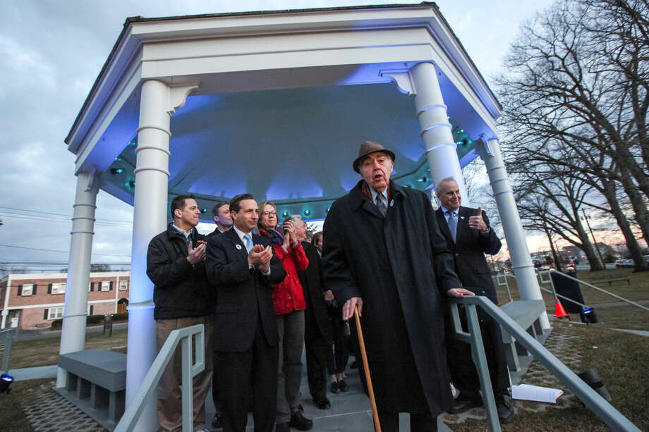 Hour photo/Chris Palermo. Former Norwalk Mayor Frank Zullo speaks among other Norwalk dignitaries in recognition of April as Autism Aqarenes Month at the Norwalk Green Gazebo Monday night. The gazebo will remain blue for the entire month of April.