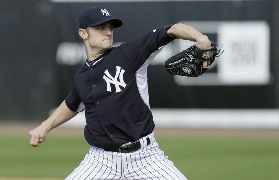 FILE - In this Feb. 15, 2014 file photo, New York Yankees relief pitcher David Robertson participates in a drill during spring training baseball practice in Tampa, Fla. With Mariano Rivera relaxing in retirement, David Robertson takes over for the greatest closer in baseball history. (AP Photo/Charlie Neibergall, File)