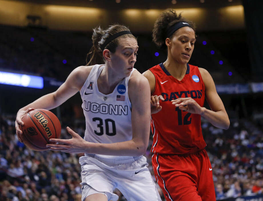 Connecticut forward Breanna Stewart (30) grabs a rebound in front of Dayton center Jodie Cornelie-Sigmundova, of France, during the second half of a regional final game in the NCAA women's college basketball tournament Monday, March 30, 2015, in Albany, N.Y. (AP Photo/Mike Groll)