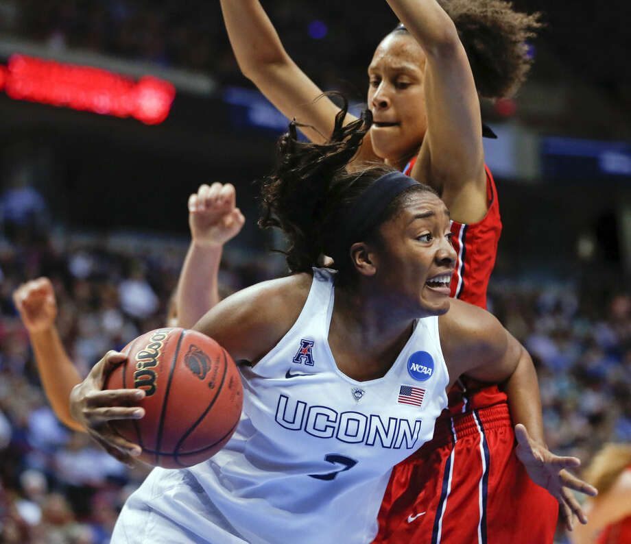 Connecticut forward Morgan Tuck, front, drives against Dayton center Jodie Cornelie-Sigmundova, of France during the first half of a regional final game in the NCAA women's college basketball tournament on Monday, March 30, 2015, in Albany, N.Y. (AP Photo/Mike Groll)