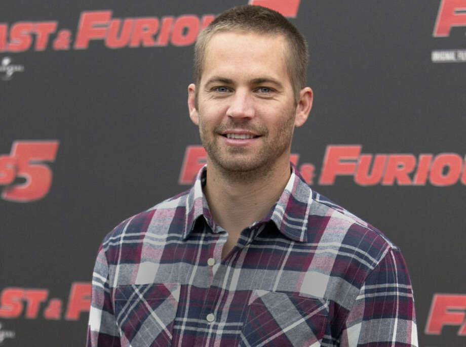 "FILE - In this April 29, 2011 file photo, actor Paul Walker poses during the photo call of the movie ""Fast and Furious 5,"" in Rome. Crash investigators have determined that the Porsche was traveling approximately 90 mph when it lost control on a city street and smashed into a light pole, killing the actor and his friend Roger Rodas. A person who has reviewed the investigators' report told The Associated Press that it concluded unsafe driving, not mechanical problems, caused the crash. The person requested anonymity because the report has not been officially released yet.AP Photo/Andrew Medichini, File)"