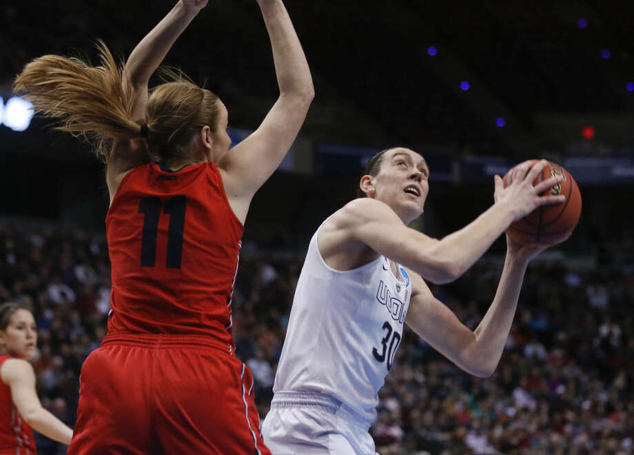 Connecticut forward Breanna Stewart (30) shoots against Dayton forward Ally Malott (11) during the first half of a regional final game in the NCAA women's college basketball tournament Monday, March 30, 2015, in Albany, N.Y. (AP Photo/Mike Groll)