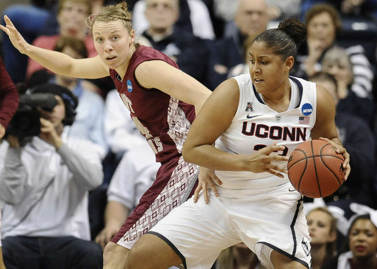 Connecticut's Kaleena Mosqueda-Lewis is guarded by Saint Joseph's Kelsey Berger, left, during the first half of a second-round game of the NCAA women's college basketball tournament, Tuesday, March 25, 2014, in Storrs, Conn. (AP Photo/Jessica Hill)