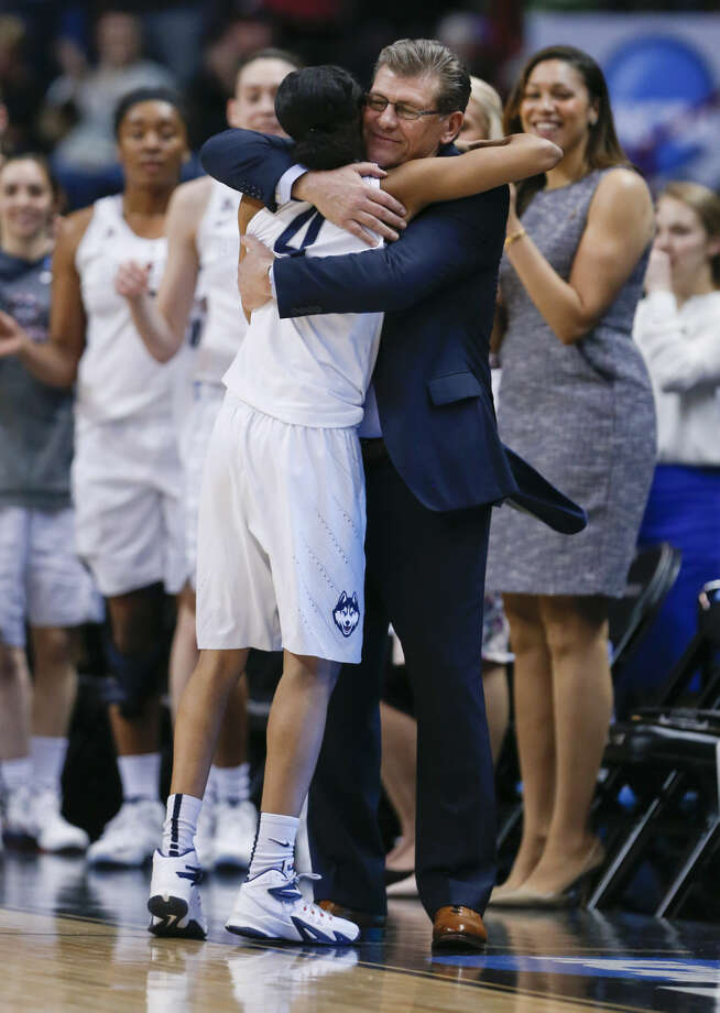 Connecticut head coach Geno Auriemma hugs guard Moriah Jefferson at the end of their 91-70 win over Dayton in a regional final game in the NCAA women's college basketball tournament on Monday, March 30, 2015, in Albany, N.Y. (AP Photo/Mike Groll)