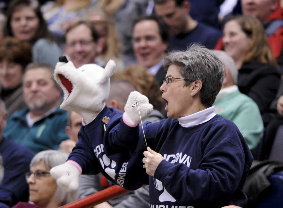 A Connecticut fan holds a puppet during the second half of a regional final game against Dayton in the NCAA women's college basketball tournament on Monday, March 30, 2015, in Albany, N.Y. (AP Photo/Tim Roske)