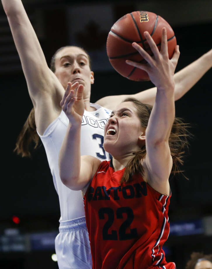 Dayton guard Kelley Austria (22) drives against Connecticut forward Breanna Stewart during the second half of a regional final game in the NCAA women's college basketball tournament on Monday, March 30, 2015, in Albany, N.Y. (AP Photo/Mike Groll)