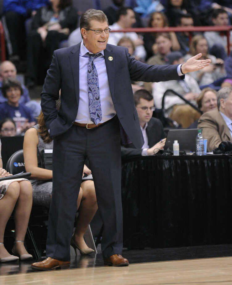 Connecticut head coach Geno Auriemma gestures during the first half of a regional final game against Dayton in the NCAA women's college basketball tournament Monday, March 30, 2015, in Albany, N.Y. (AP Photo/Tim Roske)
