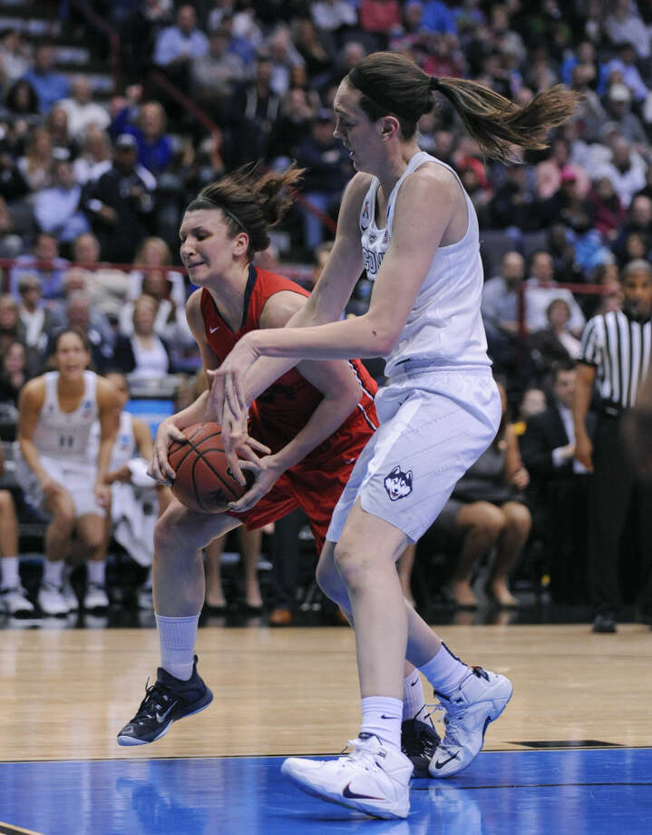 Dayton guard Andrea Hoover, left, steals the ball from Connecticut forward Breanna Stewart during the first half of a regional final game in the NCAA women's college basketball tournament Monday, March 30, 2015, in Albany, N.Y. (AP Photo/Tim Roske)