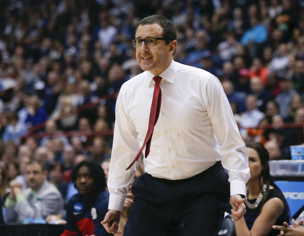 Dayton head coach Jim Jabir walks along the sideline during the first half of a regional final game against Connecticut in the NCAA women's college basketball tournament Monday, March 30, 2015, in Albany, N.Y. (AP Photo/Mike Groll)