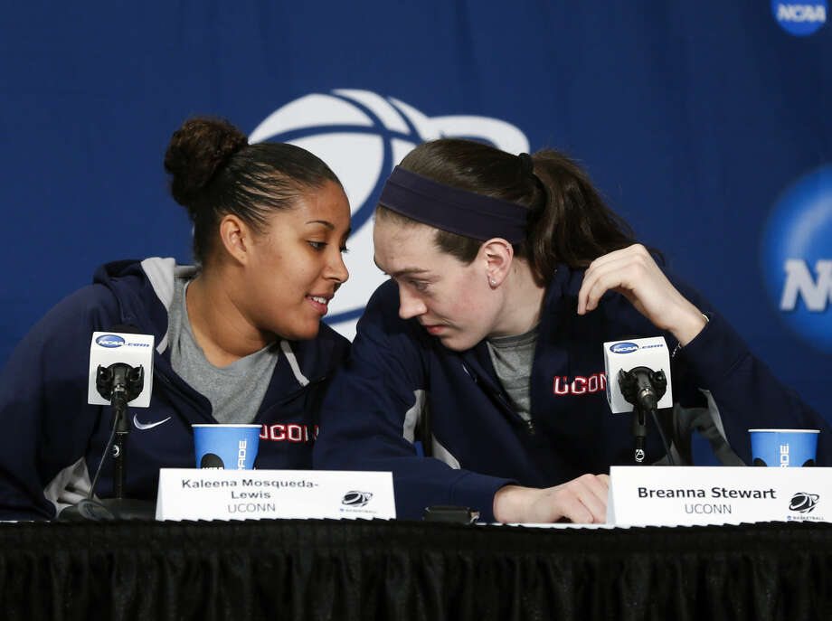 Connecticut players Kaleena Mosqueda-Lewis, left, and Breanna Stewart talk during a news conference for a women's college basketball regional final game in the NCAA Tournament on Sunday, March 29, 2015, in Albany, N.Y. UConn plays Dayton on Monday. (AP Photo/Mike Groll)