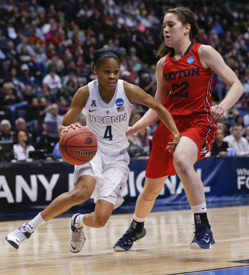 Connecticut guard Moriah Jefferson (4) drives past Dayton guard Kelley Austria (22) during the first half of a regional final game in the NCAA women's college basketball tournament on Monday, March 30, 2015, in Albany, N.Y. (AP Photo/Mike Groll)