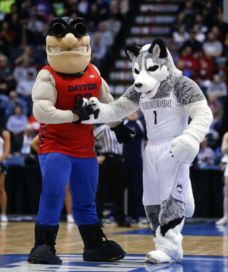 The Dayton and Connecticut mascots perform during the first half of a regional final game in the NCAA women's college basketball tournament on Monday, March 30, 2015, in Albany, N.Y. (AP Photo/Mike Groll)