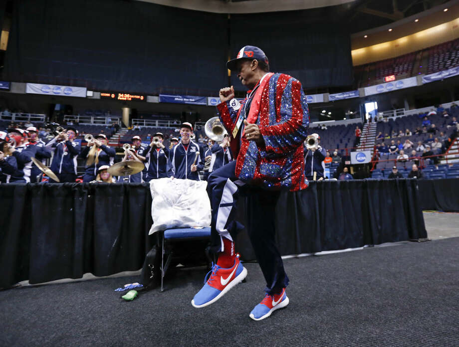Dayton pep band leader Willie Morris performs before a regional final game between Dayton and Connecticut in the NCAA women's college basketball tournament Monday, March 30, 2015, in Albany, N.Y. (AP Photo/Mike Groll)