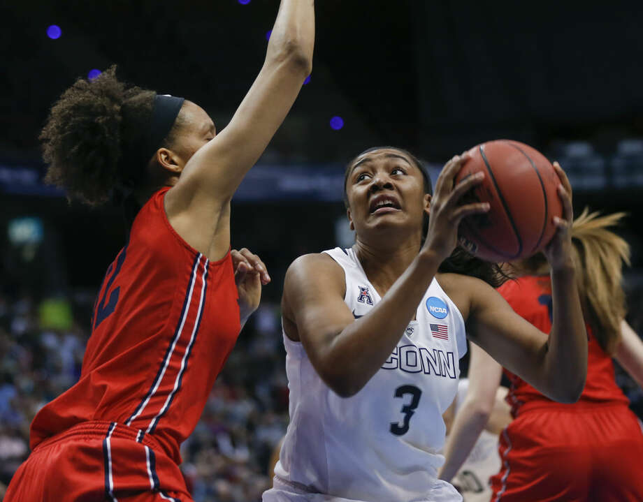 Connecticut forward Morgan Tuck (3) drives against Dayton center Jodie Cornelie-Sigmundova, of France, left, during the first half of a regional final game in the NCAA women's college basketball tournament on Monday, March 30, 2015, in Albany, N.Y. (AP Photo/Mike Groll)