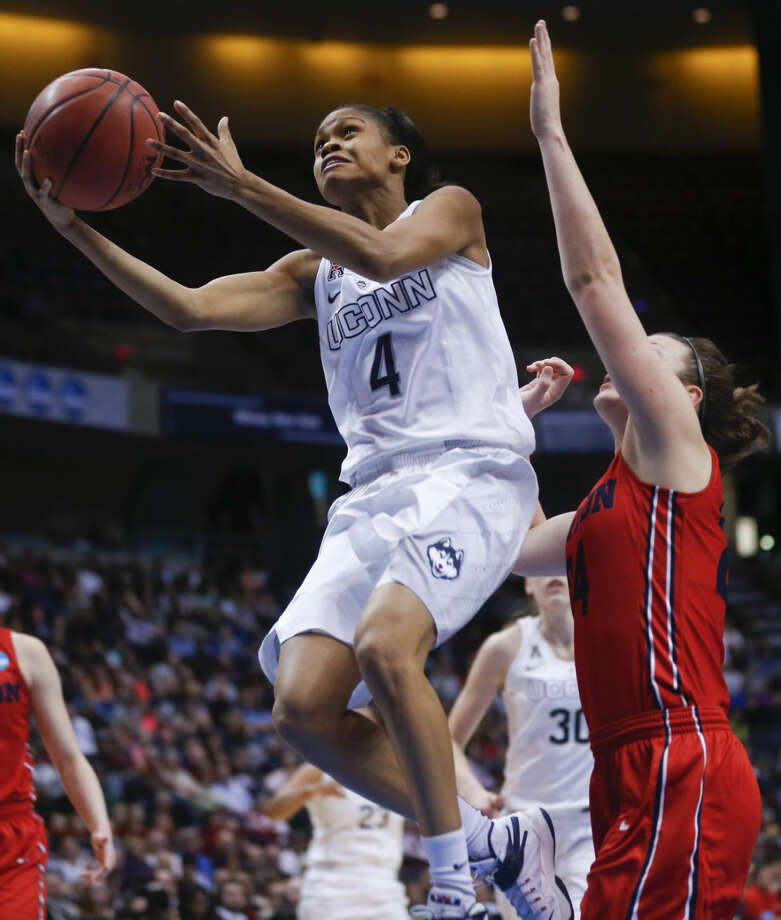 Connecticut guard Moriah Jefferson (4) shoots in front of Dayton guard Andrea Hoover during the first half of a regional final game in the NCAA women's college basketball tournament Monday, March 30, 2015, in Albany, N.Y. (AP Photo/Mike Groll)
