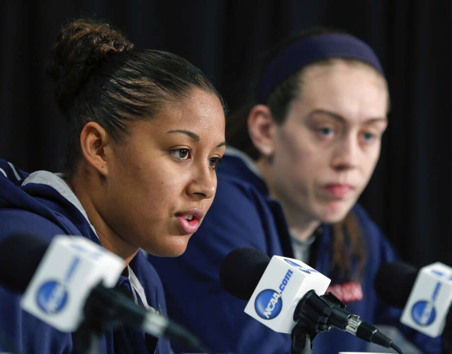Connecticut forward Kaleena Mosqueda-Lewis (23) speaks during a news conference for a women's college basketball regional final game in the NCAA Tournament on Sunday, March 29, 2015, in Albany, N.Y. Breanna Stewart is seated right. UConn plays Dayton on Monday. (AP Photo/Mike Groll)