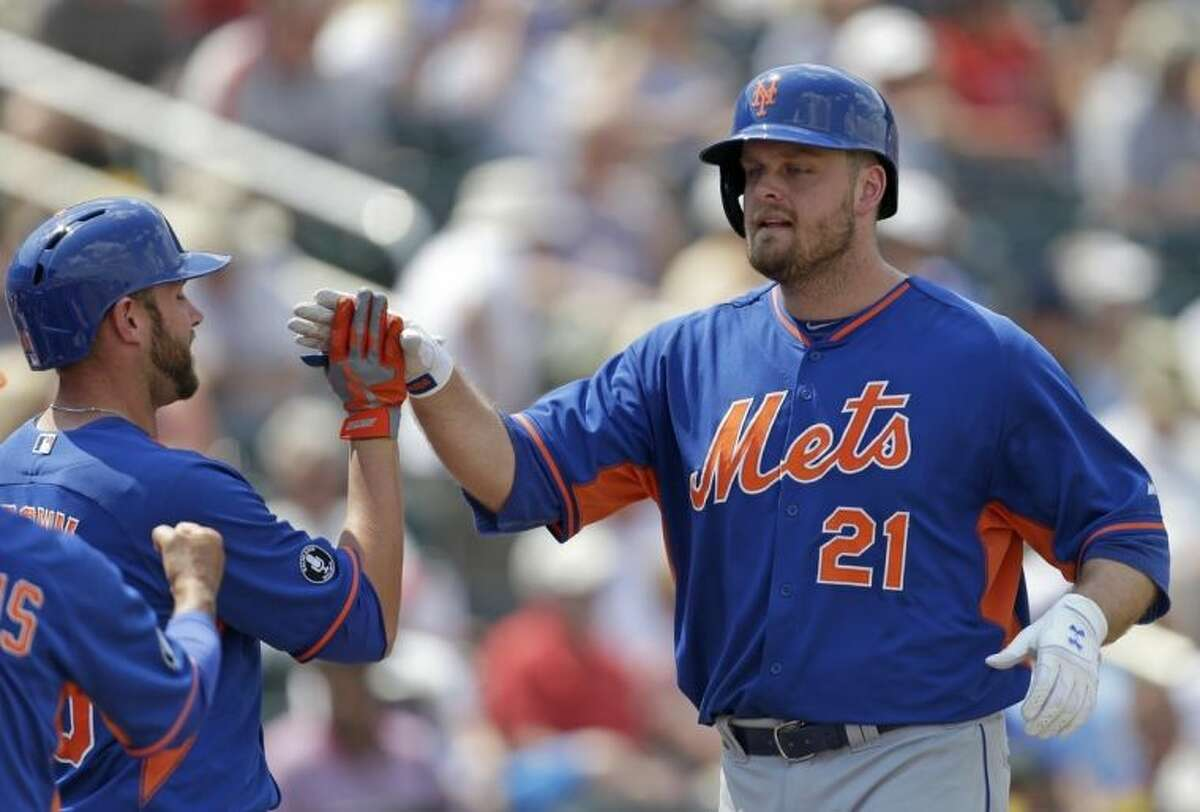 New York Mets' Lucas Duda (21) is greeted by Andrew Brown after Duda's two-run home run in the fourth inning of an exhibition baseball game against the Minnesota Twins in Fort Myers, Fla., Friday, March 21, 2014. (AP Photo/Gerald Herbert)