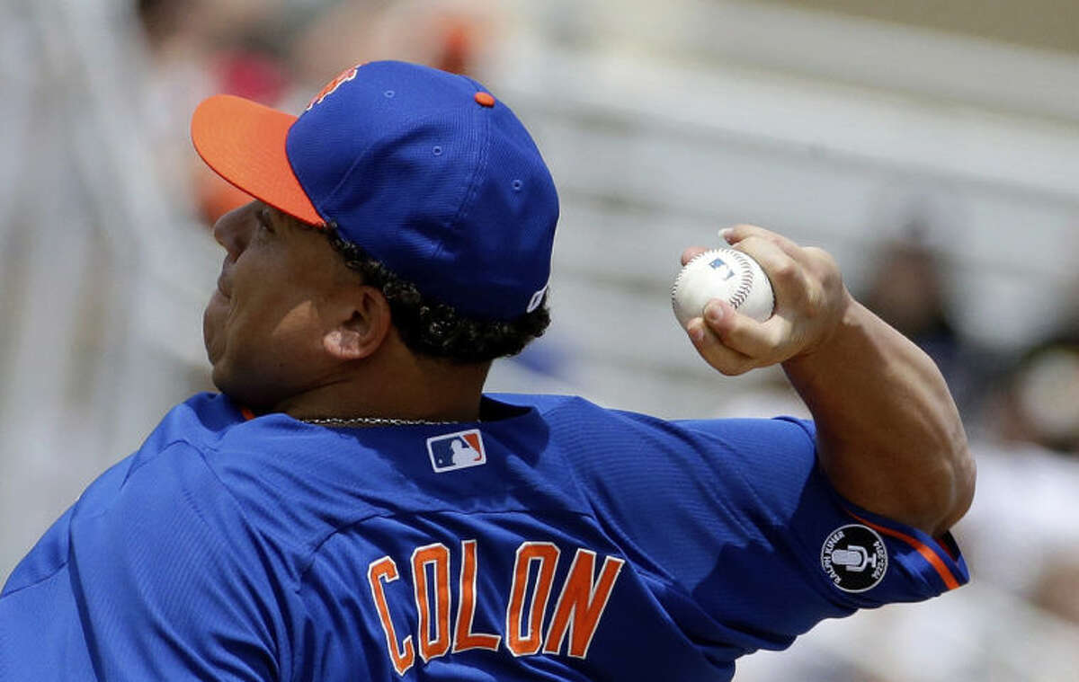 New York Mets starting pitcher Bartolo Colon throws in the first inning of an exhibition spring training baseball game against the Miami Marlins, Saturday, March 22, 2014, in Jupiter, Fla. (AP Photo/David Goldman)