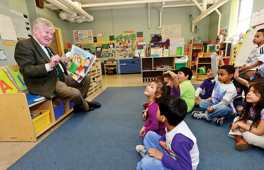 Hour photo / Erik Trautmann Interim Superintendent James A. Connelly reads a book to preschool children at the Norwalk Head Start School Readiness Program at Ben Franklin Center as part of Week of the Young Child.