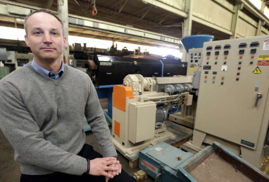 In this March 25, 2014, photo David Pietig, operations manager for Arlington Plastics Machinery, in Elk Grove Village poses. His company exports used plastic processing equipment, and the North American Free Trade Agreement has made it easier for the company to export, so much so that it has been able to hire two workers and may hire more.(AP Photo/M. Spencer Green)