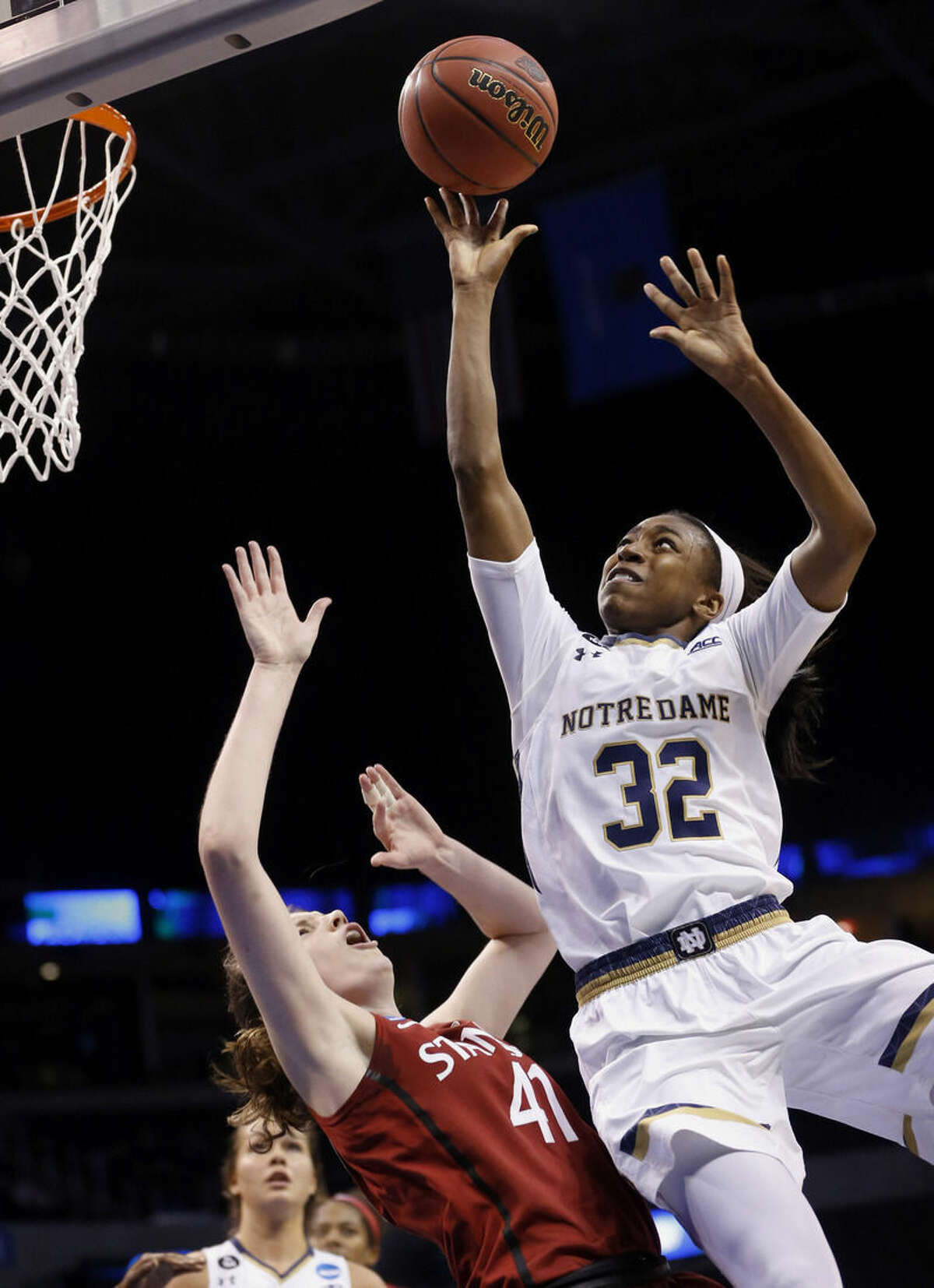 FILE - In this March 27, 2015, file photo, Notre Dame guard Jewell Loyd (32) shoots over Stanford forward Bonnie Samuelson (41) during the second half of a women's college basketball regional semifinal game in the NCAA Tournament in Oklahoma City. Loyd was selected to the AP All-America team, Tuesday, March 31, 2015. (AP Photo/Sue Ogrocki, File)