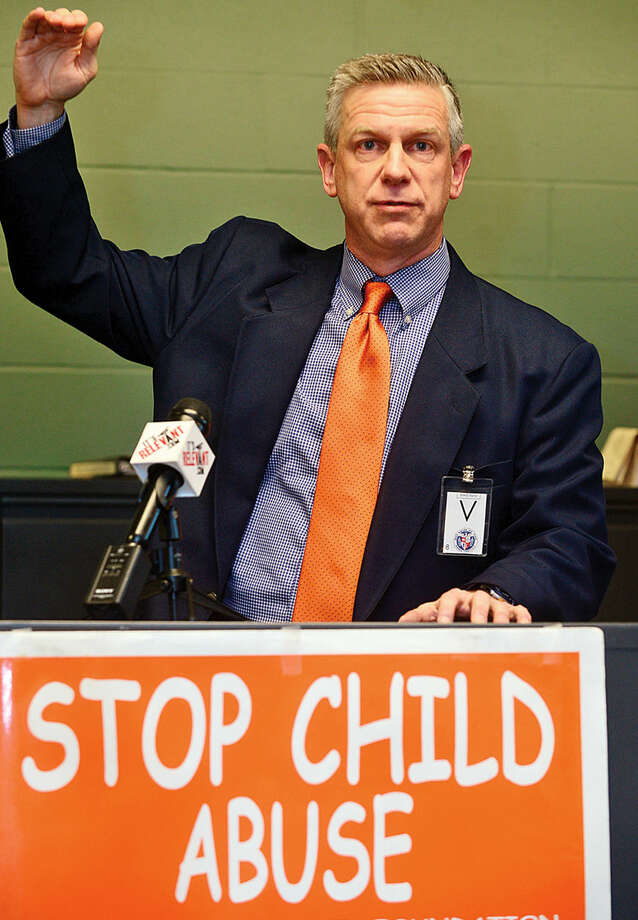 Hour photo / Erik Trautmann The Center for Youth Leadership at Brien McMahon High School hold a press conference to launch April as National Child Abuse Awareness Month with speaker Brian Koonz, a columnist for Hearst Media; and a Claire Kostohryz from the Center for Youth Leadership.