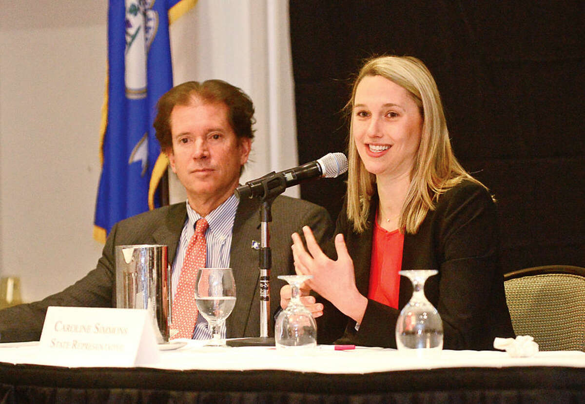Hour photo / Erik Trautmann State Represenative Caroline Simmins participates in a panel discussion during the Stamford Chamber of Commerce 16th legislative breakast with local legislators at the Stamford Crowne Plaza Tuesday monring.
