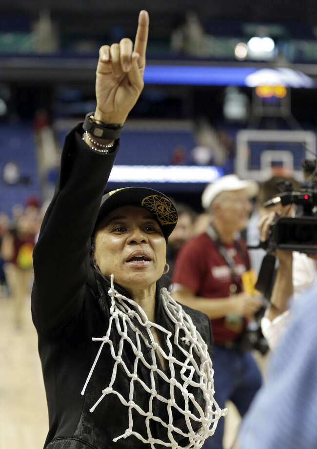 South Carolina coach Dawn Staley reacts following her team's 80-74 win over Florida State in a women's college basketball regional final game in the NCAA Tournament in Greensboro, N.C., Sunday, March 29, 2015. (AP Photo/Gerry Broome)