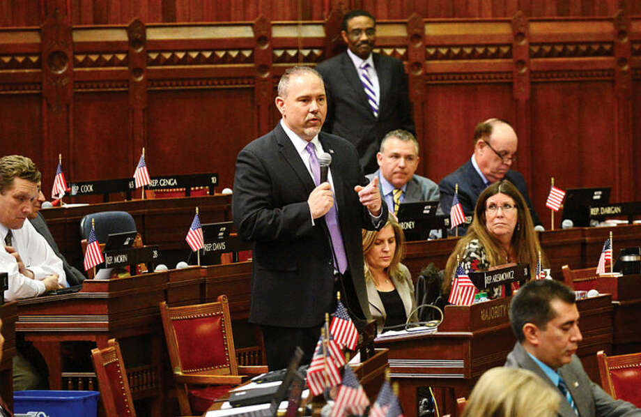 Hour photo / Erik Trautmann Colleagues in the Connecticut Legislature including Majority Leader Joe Aresimowicz (D-30) bid farewell to Minority Leader Larry Cafero (R-142) as he announces that he would not seek reelection Wednesday at the Capitol.