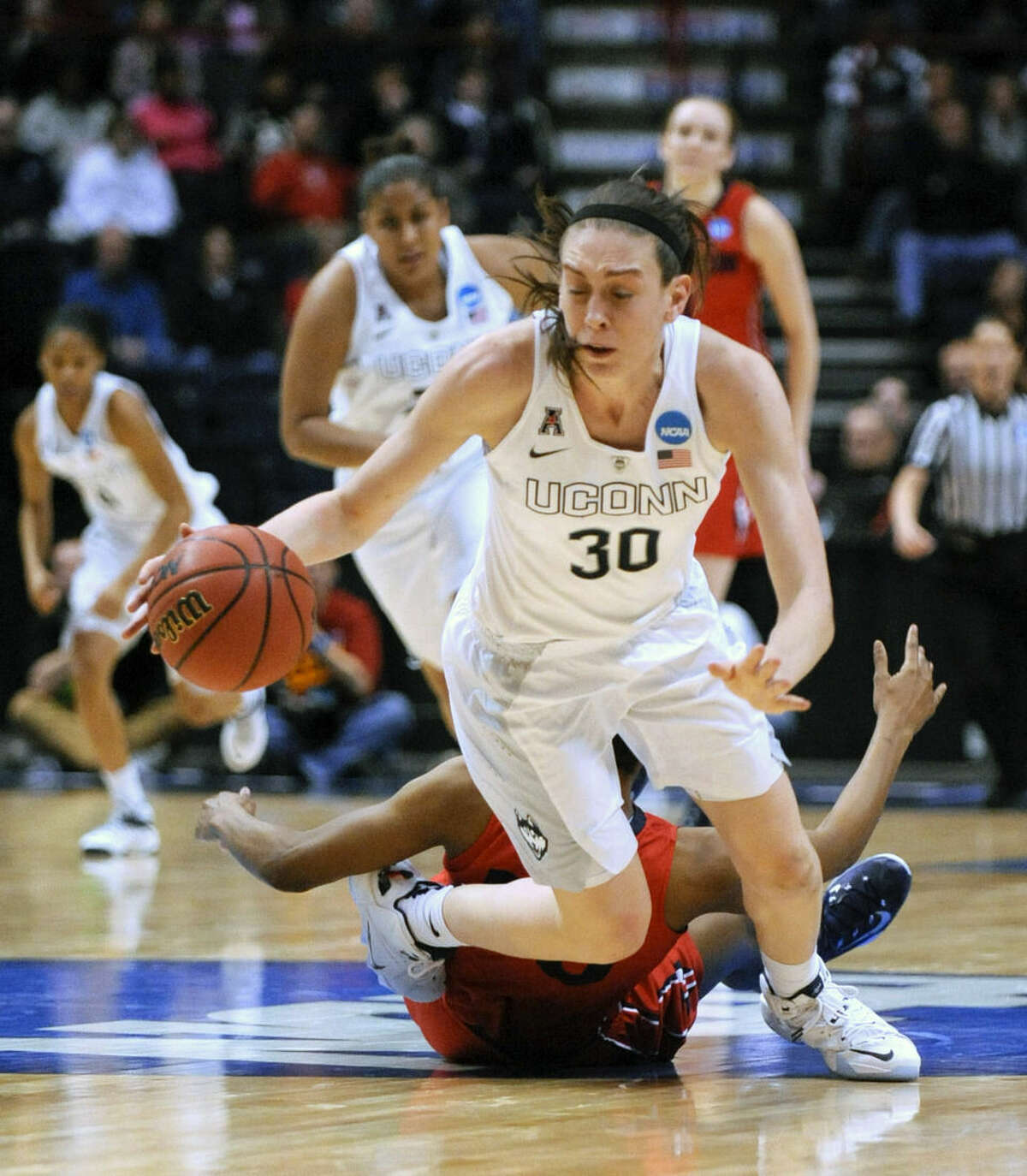 Connecticut forward Breanna Stewart (30) gets tripped by Dayton center Saicha Grant-Allen during the second half of a regional final game in the NCAA women's college basketball tournament on Monday, March 30, 2015, in Albany, N.Y. UConn won 91-70. (AP Photo/Tim Roske)