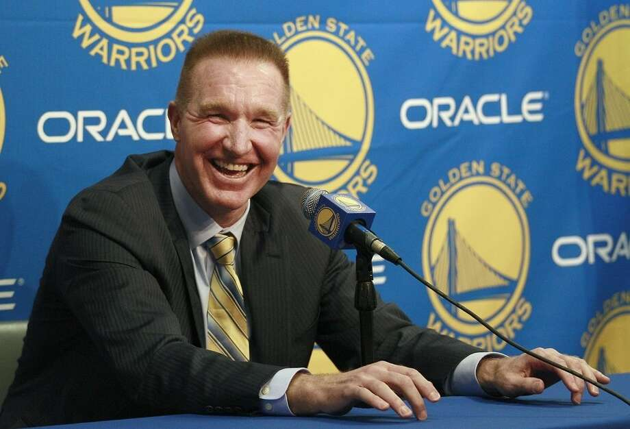 FILE - In this March 19, 2012, file photo, former Golden State Warriors player Chris Mullin laughs while speaking at a news conference before an NBA basketball game between the Warriors and the Minnesota Timberwolves in Oakland, Calif. Mullin, St. John's all-time leading scorer and still the face of its basketball program three decades after his career ended, has agreed to coach the Red Storm, a person with knowledge of the discussions told The Associated Press on Monday, March 30, 2015. The person spoke on condition of anonymity because there was no formal announcement. (AP Photo/Jeff Chiu, File)