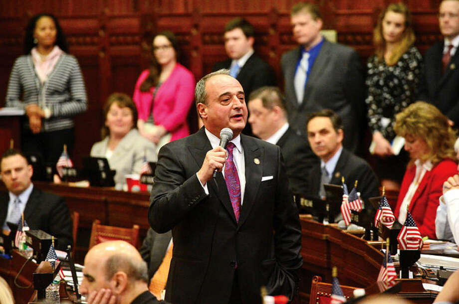 Hour photo / Erik Trautmann Minority Leader Larry Cafero (R-142) announces in the Legislature Wednesday that he would not seek reelection for another term in office.