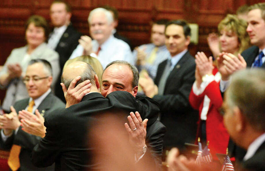 Hour photo / Erik Trautmann Colleagues in the Connecticut Legislature bid farewell to Minority Leader Larry Cafero (R-142) as he announces that he would not seek reelection Wednesday at the Capitol.