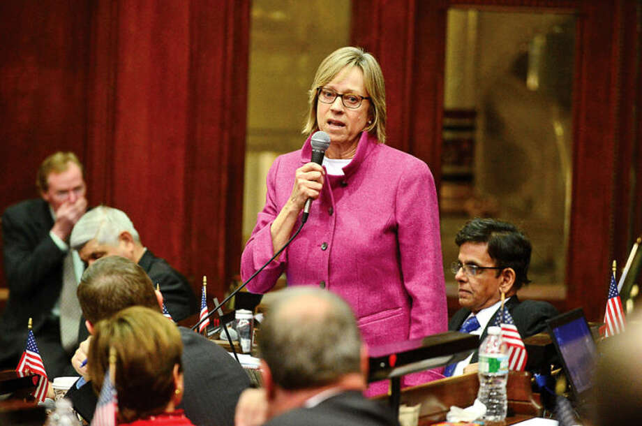 Hour photo / Erik Trautmann Colleagues in the Connecticut Legislature including Terrie Wood ( R-141) bid farewell to Minority Leader Larry Cafero (R-142) as he announces that he would not seek reelection Wednesday at the Capitol.