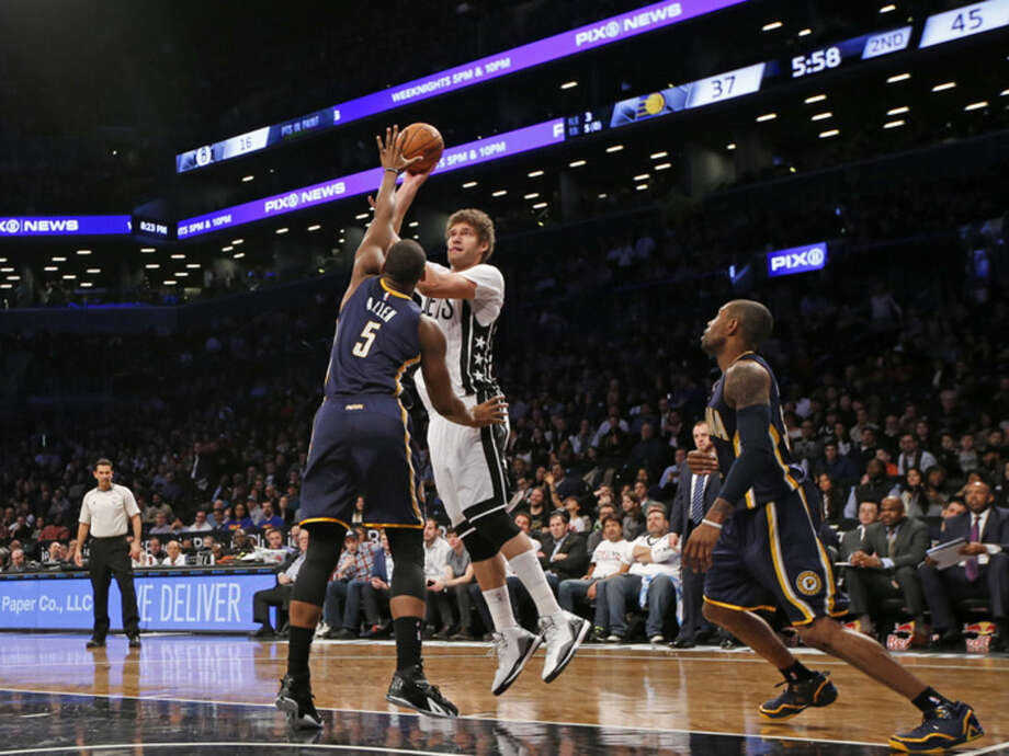 Brooklyn Nets center Brook Lopez (11) shoots over Indiana Pacers forward Lavoy Allen (5) in the first half of an NBA basketball game at the Barclays Center, Tuesday, March 31, 2015, in New York. (AP Photo/Kathy Willens)