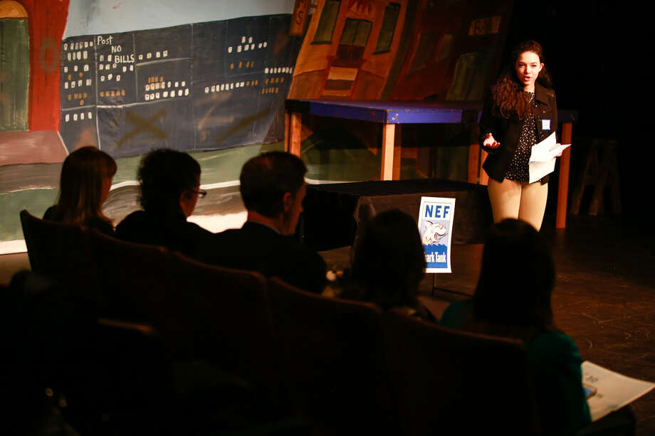 Hour photo/Chris Palermo Ara Rosato presents her proposal to the judges at the Norwalk Education Foundation's Shark Tank Tuesday night at the Music Theatre of Connecticut.