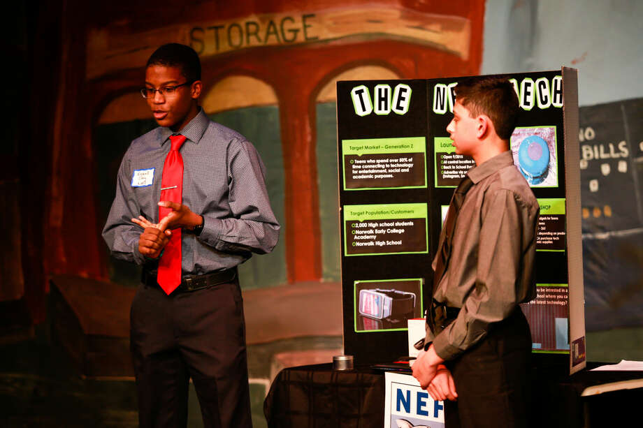 Hour photo/Chris Palermo Katrall Clay and Aasim Vhora present their NECA Tech Shop idea to the judges at the Norwalk Education Foundation's Shark Tank Tuesday night at the Music Theatre of Connecticut.