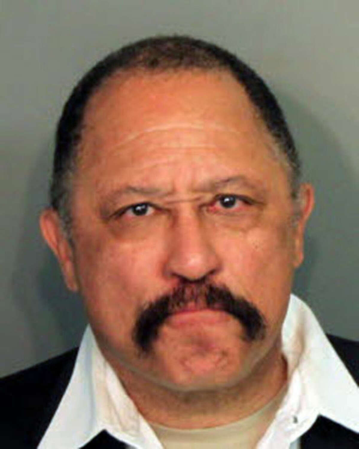 This photo provided by the Shelby County Sheriff's Office on Monday, March 24, 2014, shows Judge Joe Brown, who was arrested and charged with five counts of contempt of court in Tennessee. Shelby County Juvenile Court officials said the 66-year-old was sentenced to five days in jail after causing an outburst Monday in a courtroom hearing. The former TV show star is running for Shelby County District Attorney General. (AP Photo/Shelby County Sheriff's Office)