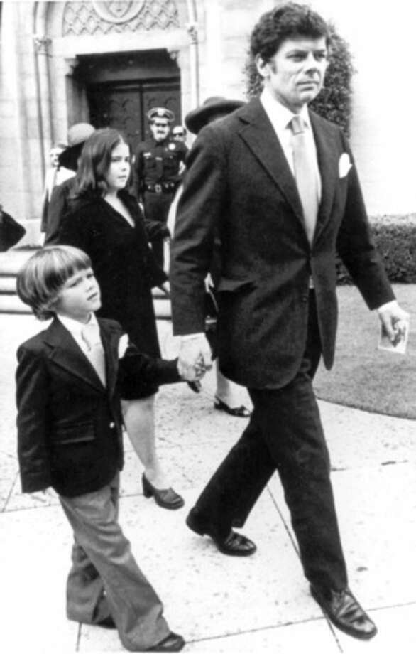 FILE - In this June 10, 1976 file photo, Gordon Getty with his son Andrew leaves the Wilshire United Methodist church after memorial services for J. Paul Getty, in Los Angeles. A man has been found dead at the Hollywood Hills home of Andrew Getty, grandson of the late J. Paul Getty and heir to the Getty oil fortune - but they haven't confirmed that it is Getty. Los Angeles police Officer Jack Richter says officers went to the home shortly after 2:15 p.m. Tuesday, March 31, 2015, after a woman called to say someone in the house had died. (AP Photo/File)