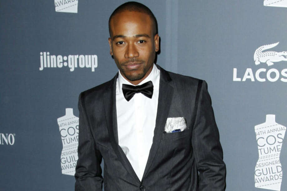 FILE - In this Feb. 21, 2012 file photo, actor Columbus Short arrives at the 14th Annual Costume Designers Guild Awards at the The Beverly Hilton hotel in Beverly Hills, Calif. Short was arrested on Wednesday, March 26, 2014, on a felony battery case filed after he knocked a man out in a West Hollywood restaurant during an altercation on March 15, 2014. (AP Photo/Matt Sayles, file)