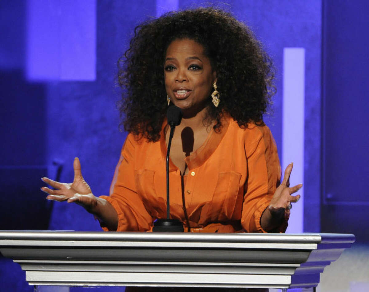 FILE - This Feb. 22, 2014 file photo shows Oprah Winfrey speaking at the 45th NAACP Image Awards in Pasadena, Calif. Winfrey will visit eight cities this fall for a two-day arena event called ?