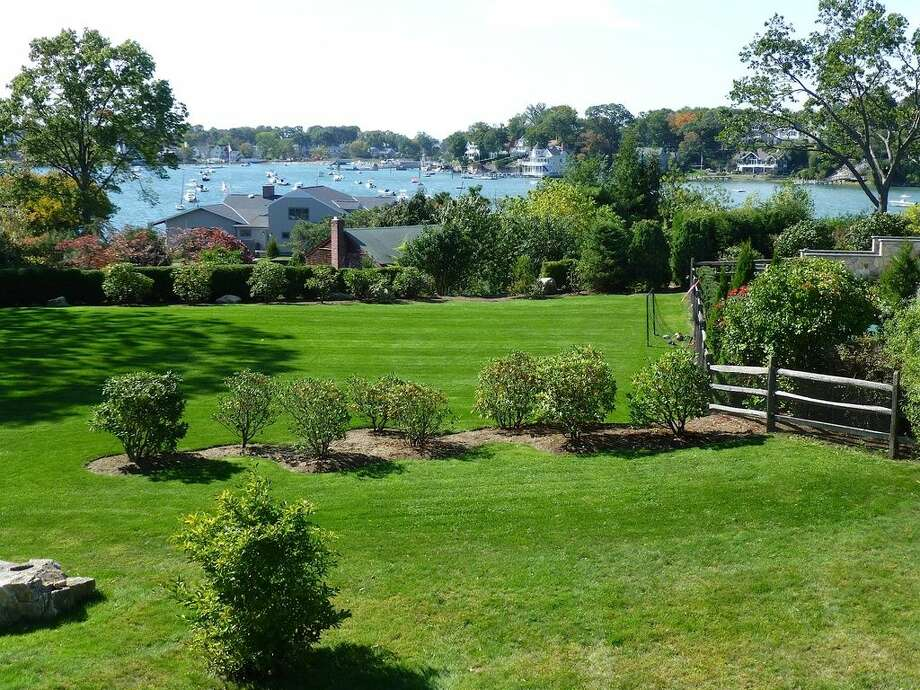 16 Point Rd, Norwalk, CT 068545 beds4 baths2,798 sqftFeatures: Wet bar, stone patiowith covered dining area and water fountain, private beach, tennis courts, dock(Credit:Zillow)