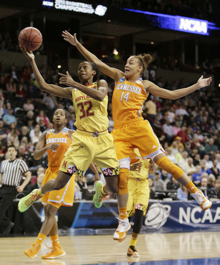 Maryland's Shatori Walker-Kimbrough (32) shoots against Tennessee's Andraya Carter (14) during the second half of a women's college basketball regional final game in the NCAA tournament, Monday, March 30, 2015, in Spokane, Wash. Maryland won 58-48. (AP Photo/Young Kwak)