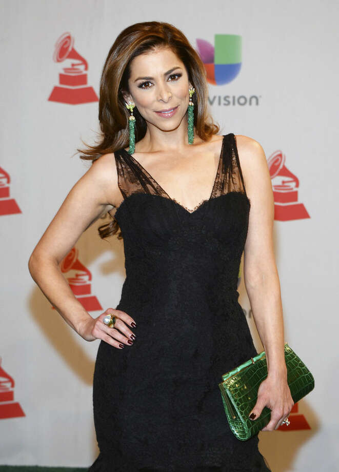"""FILE - In this Nov. 20, 2014 file photo, Lourdes Stephen arrives at the 15th annual Latin Grammy Awards in Las Vegas. Jomari Goyso and Carlos Calderon will join Stephen as hosts of """"Sal y Pimienta,"""" replacing Rodner Figueroa, who was fired for comments he made about first lady Michelle Obama. (Photo by Al Powers/Invision/AP, File)"""