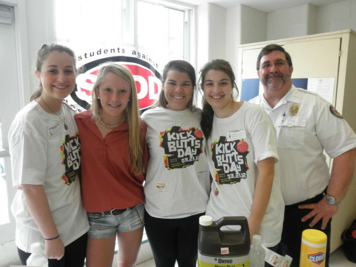 """SADD members Colleen Heaney, Haley Close, Sloane Clarke, Caroline Feehan,and Fire Marshal Bob Buch at """"Kick Butts Day"""" at Middlesex Middle School, one of the many national events in which the Darien chapter of SADD participates."""